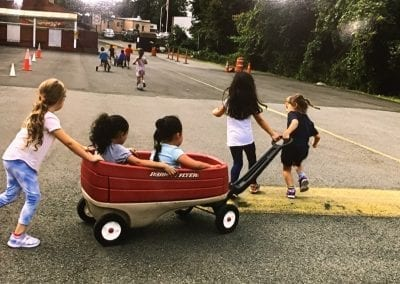 tom thumb summer camp pulling the wagon of kids