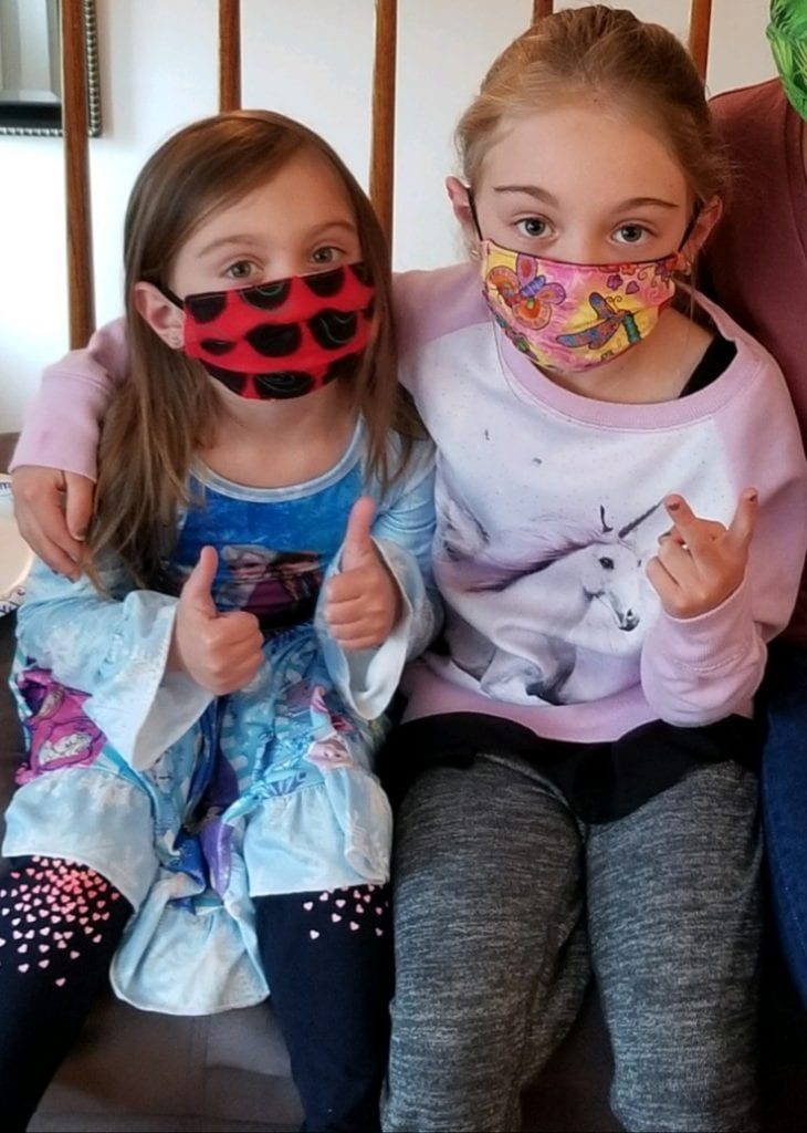 Adelyn and Aubree wearing their masks