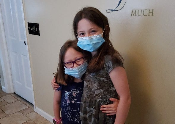 Jackie and Lia Wearing Masks